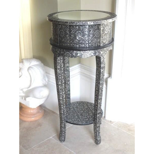 Blackened silver embossed metal circular bedside table