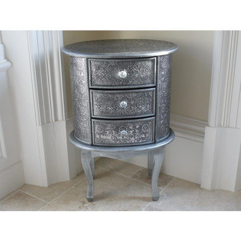 Blackened silver embossed metal oval bedside table