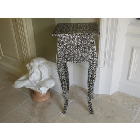 Blackened silver embossed metal bedside chest table