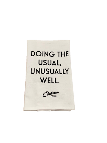 """Doing the Usual, Unusually Well"" Tea Towel"