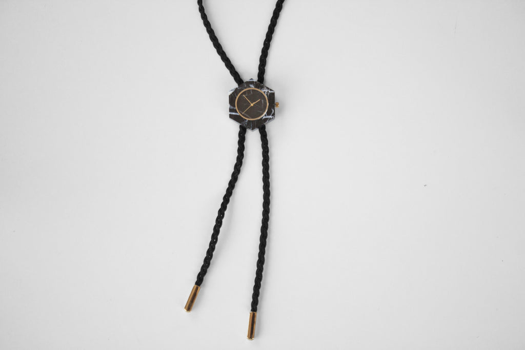 Solid black marble bolo tie with braided bolo and gold finishing for the chic and unique