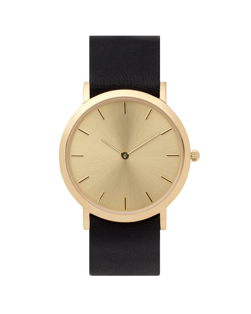 Unisex wristwatch with minimal gold dial face and premium black leather nato style strap