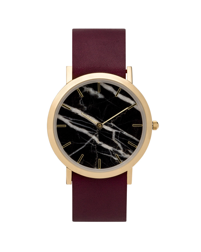 Wristwatch with genuine black marble dial face, gold finishing and a premium cherry leather strap