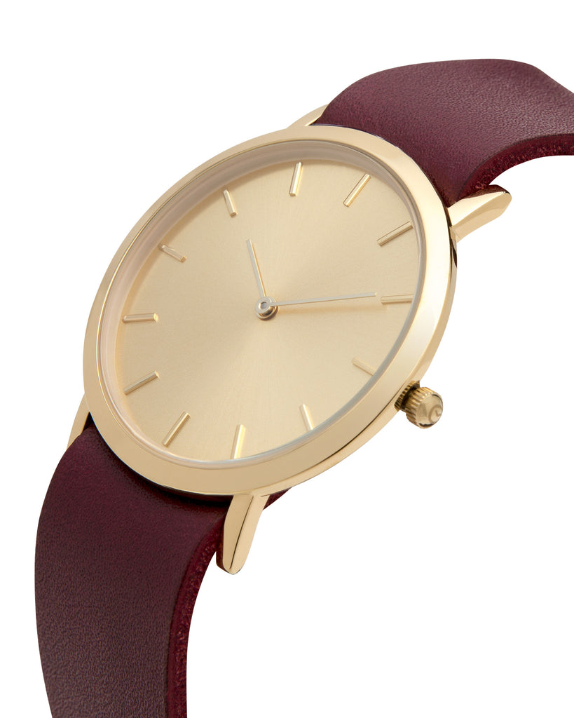 Unisex wristwatch with minimal gold dial face and premium cherry leather nato style strap