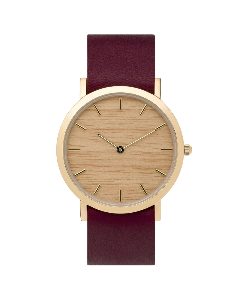 Minimal wristwatch with genuine silverheart wood dial face with premium cherry leather nato styled strap