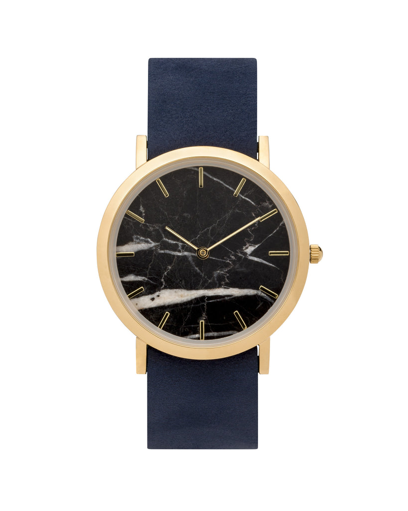 Wristwatch with genuine black marble dial face, gold finishing and a premium navy leather strap