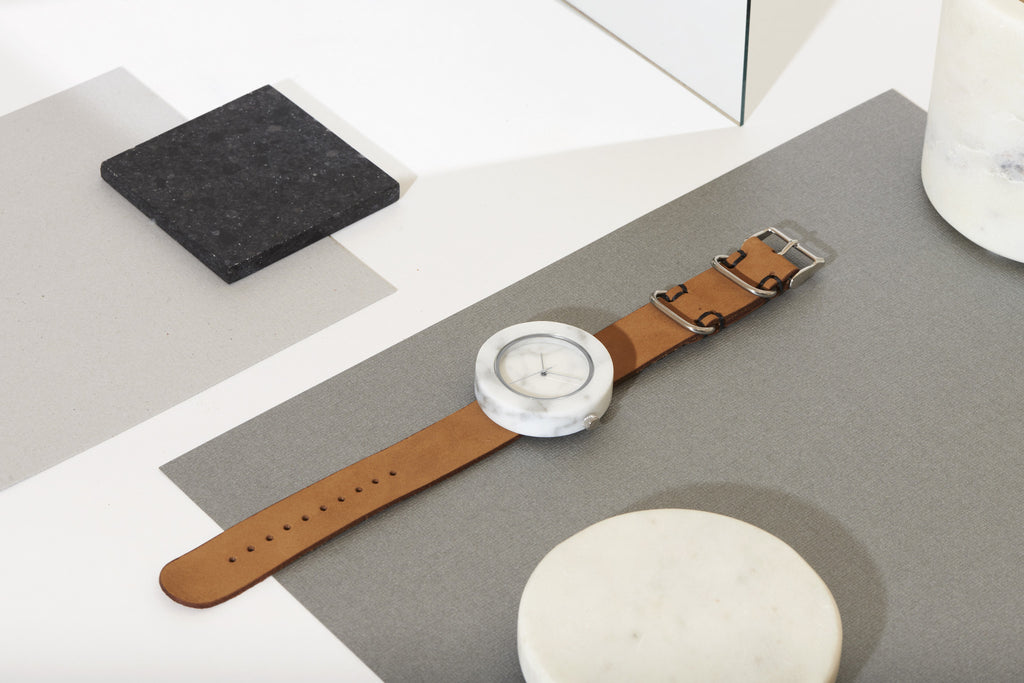 Unisex solid white marble circular watch with silver finishing and premium tan leather strap