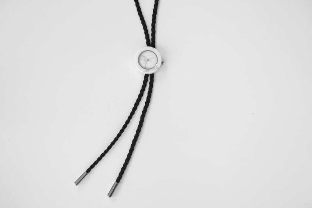 Solid white marble bolo tie with braided bolo and silver finishing for the chic and unique