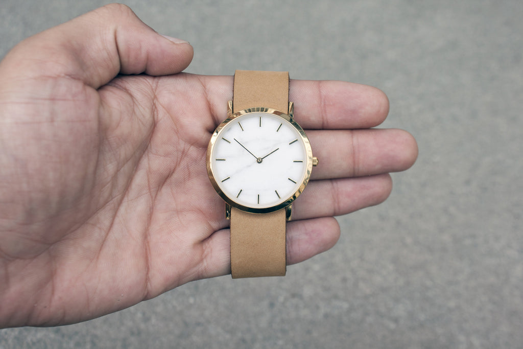 Wristwatch with genuine white marble dial face and a premium tan leather nato style strap for all lovers of natural materials