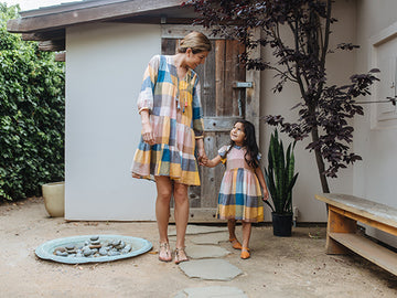Mom and daughter wear their matching multi gingham dresses. Click to view the full Mommy & Me Collection for Spring 2020.