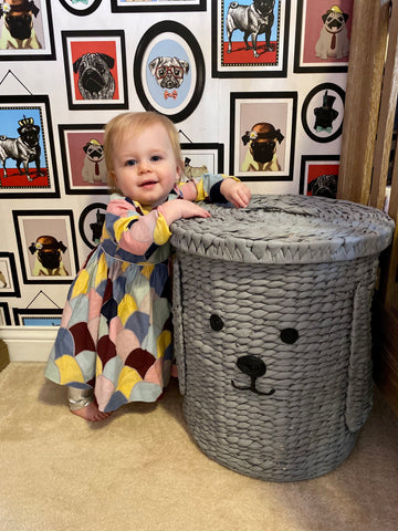 Violet shows off her Amma Dress and dog photos.