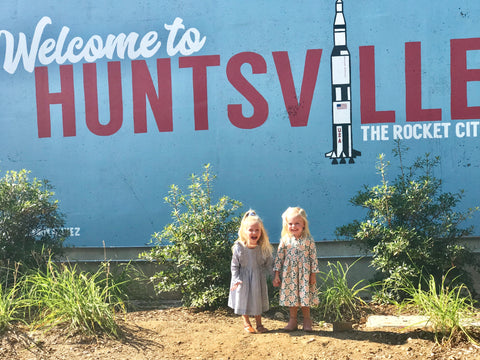 Miller and Margot pose in front of the Welcome to Huntsville sign!