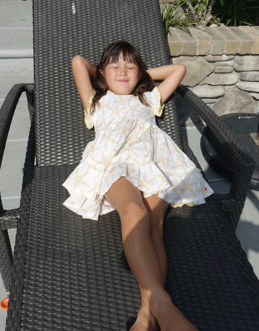 Kelsey lays in the sun in her Niley Dress.