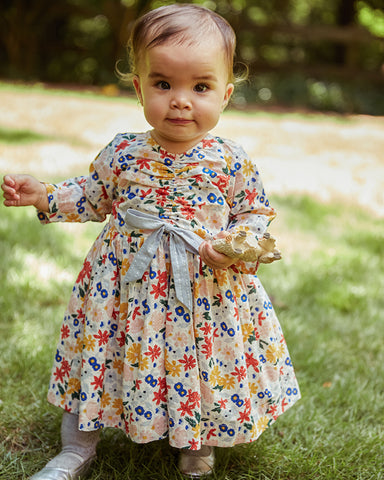baby in Lucy Dress Set.