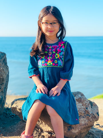 Luna wearing her Arianna Dress in front of the water.
