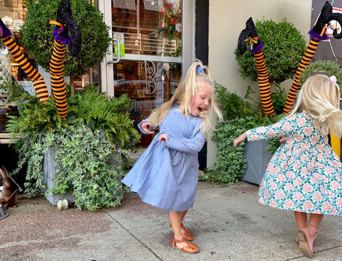 Flock stars miller and margot dance their hearts out in downtown huntsville in their Pink Chicken frocks.
