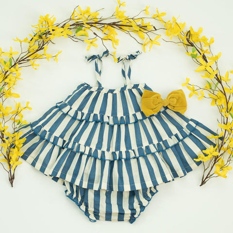 Baby Garden 2-piece set in dress blues stripe/white, decorated with yellow floral arrangement and yellow bow.