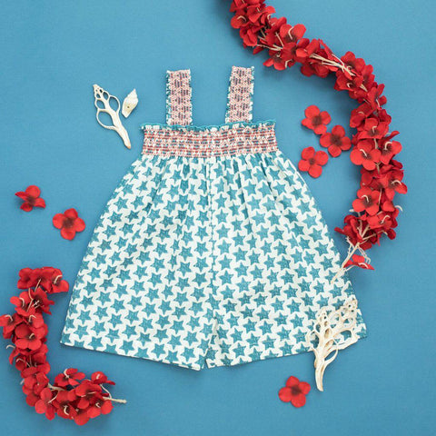 Flatlay of Red white and blue baby Eleven Jumper in stars print.