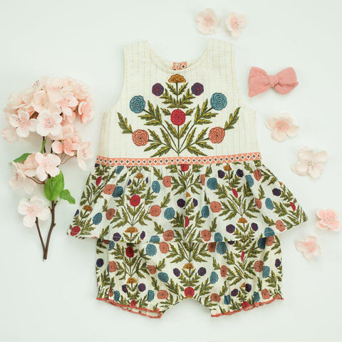 Libby 2 piece set in multi-marigold floral print. Surrounded by pink flowers and bows.