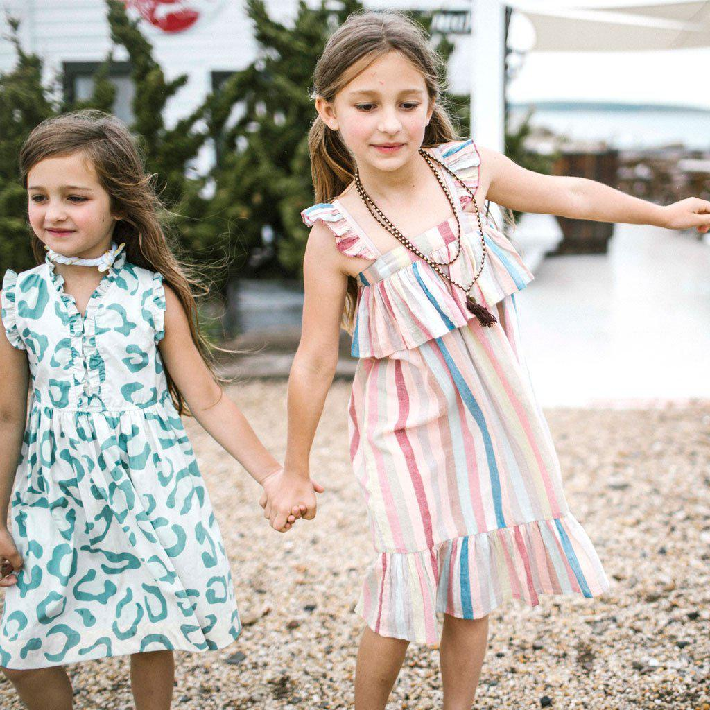 Two models in Pink Chicken wearing Amalia Dress 2y multi vintage stripe - 19spc284a and Vera Dress 2y milky green oversized leopard - 19spc311a