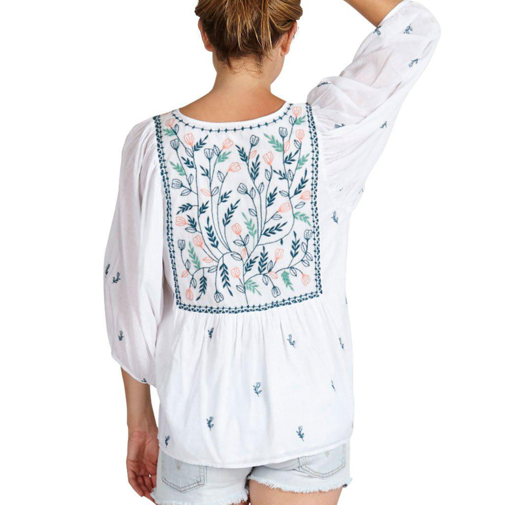 Ava Bella top for women. White with floral embroidery. Back view.