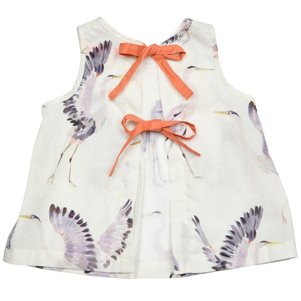 Back of the top of Pink Chicken 2-piece Jaipur set in antique white with heron print with orange bows