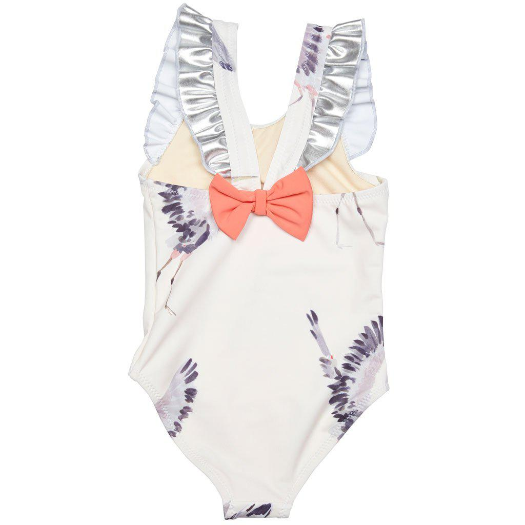 Back of Pink Chicken one-piece Liv bathing suit in antique white with heron print with ruffle trim and bow back