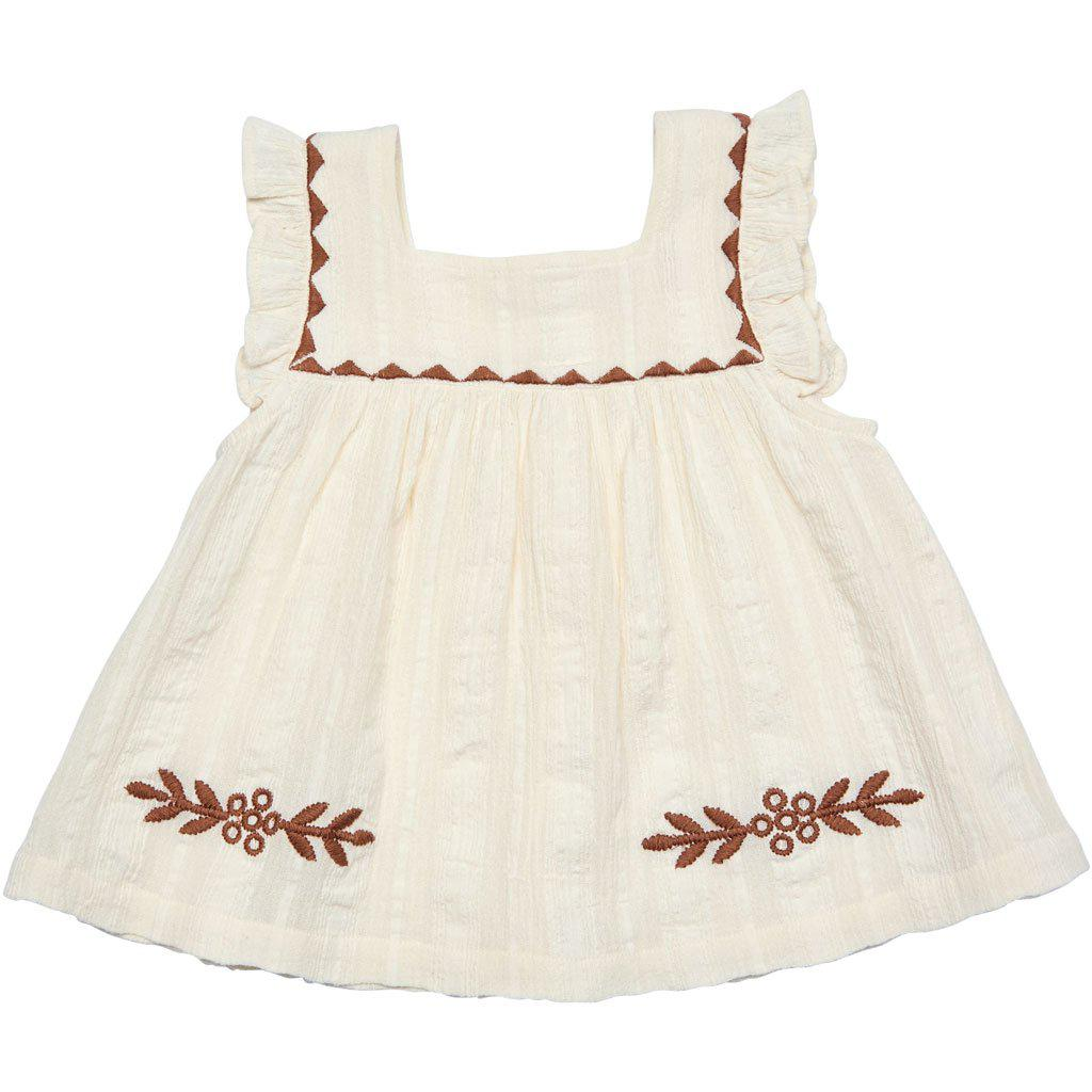Marabelle top in antique white with neutral floral embroidery.