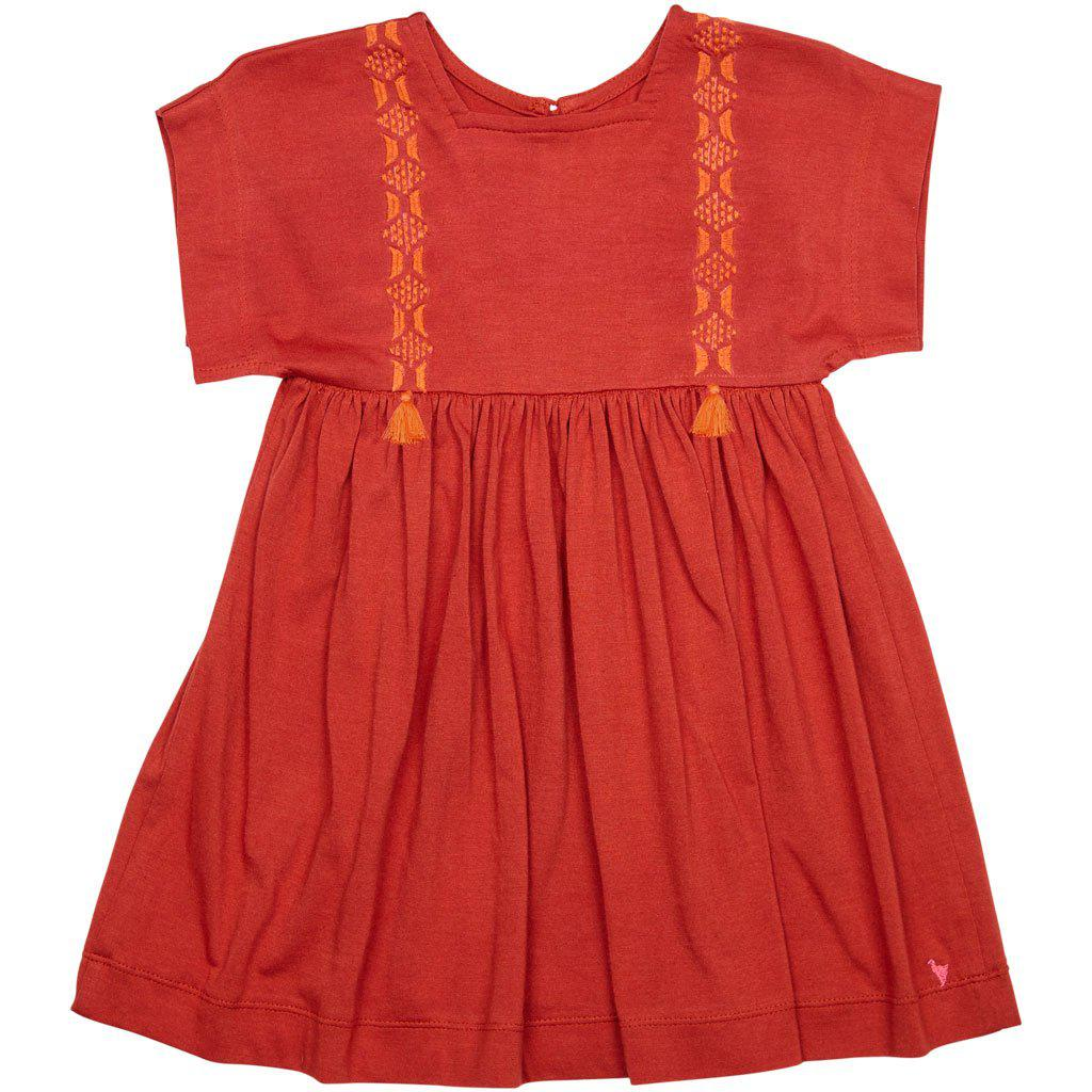 Stacey dress in tandoori spice colorway. With embroidery and tassel details.