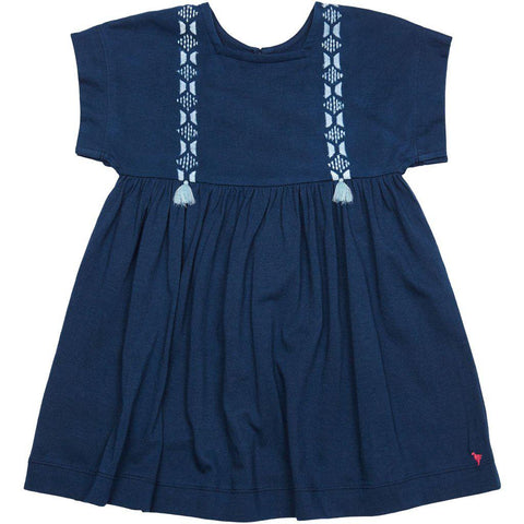 Stacey dress in dress blues colorway. Embroidery and tassel details.