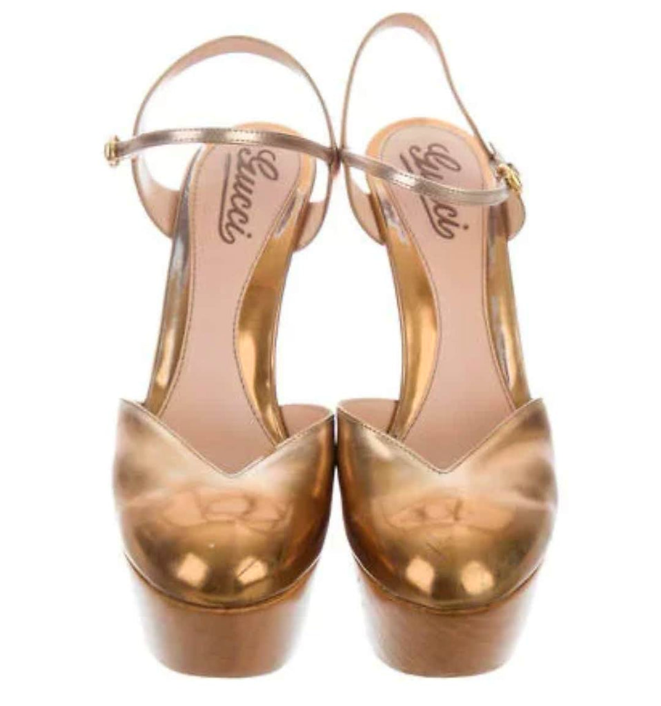 GUCCI METALLIC PLATFORM PUMPS