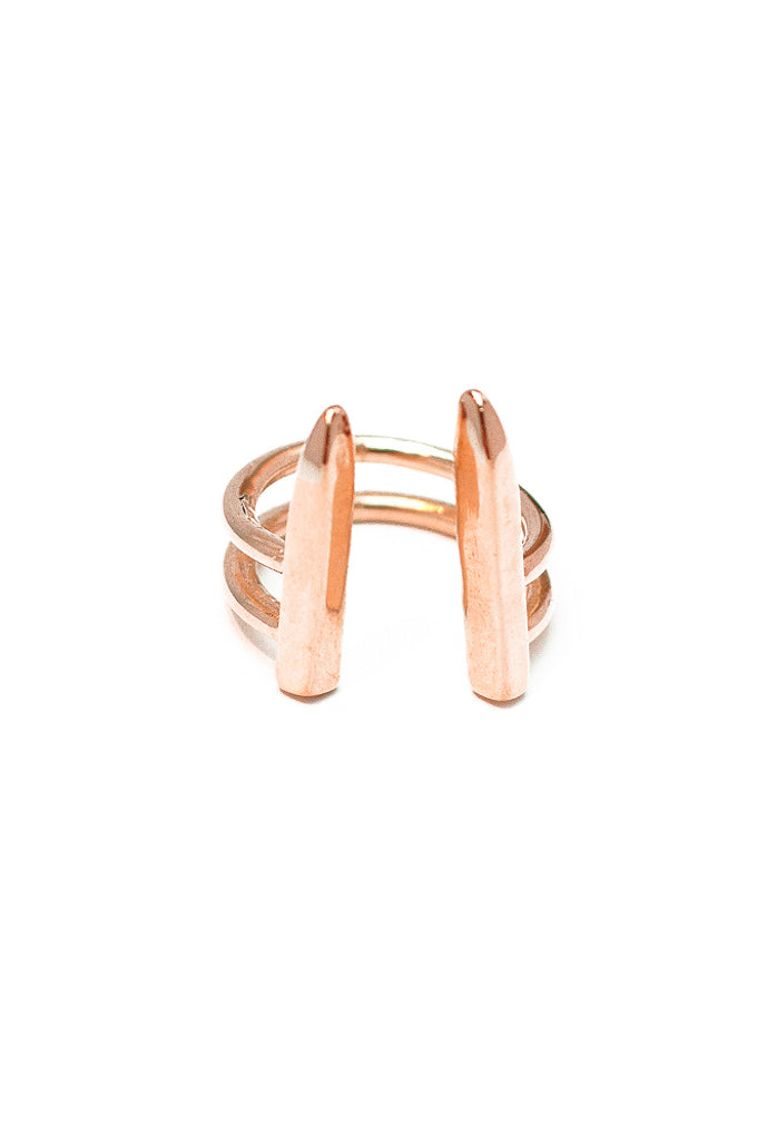Dagger ring in 14k rose gold. Adjustable ring for sizes 5 through 8. With a modern armor dagger design. Handmade by local jewelry designer, Nina Berenato, in Austin, Texas.