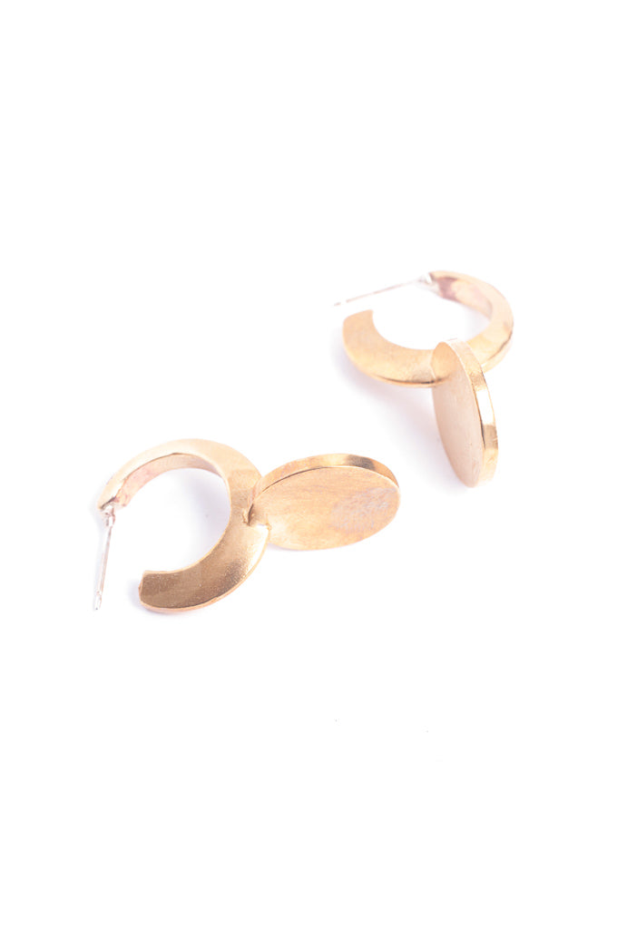 Cycle earring in 14k yellow gold. Earring with a modern circular design. Handmade by local jewelry designer, Nina Berenato, in Austin, Texas.