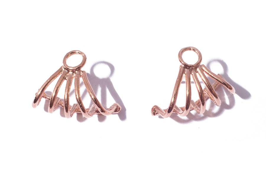 Inferno earring in 14k rose gold. Earring that tucks underneath and hugs the lobe of the ear. Handmade by local jewelry designer, Nina Berenato, in Austin, Texas.