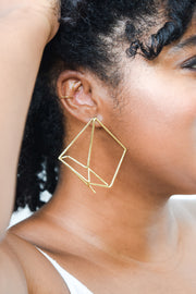 Matrix earring on model. 14k gold earring with web like geometric design. Hand made by local designer, Nina Berenato, in Austin, TX.