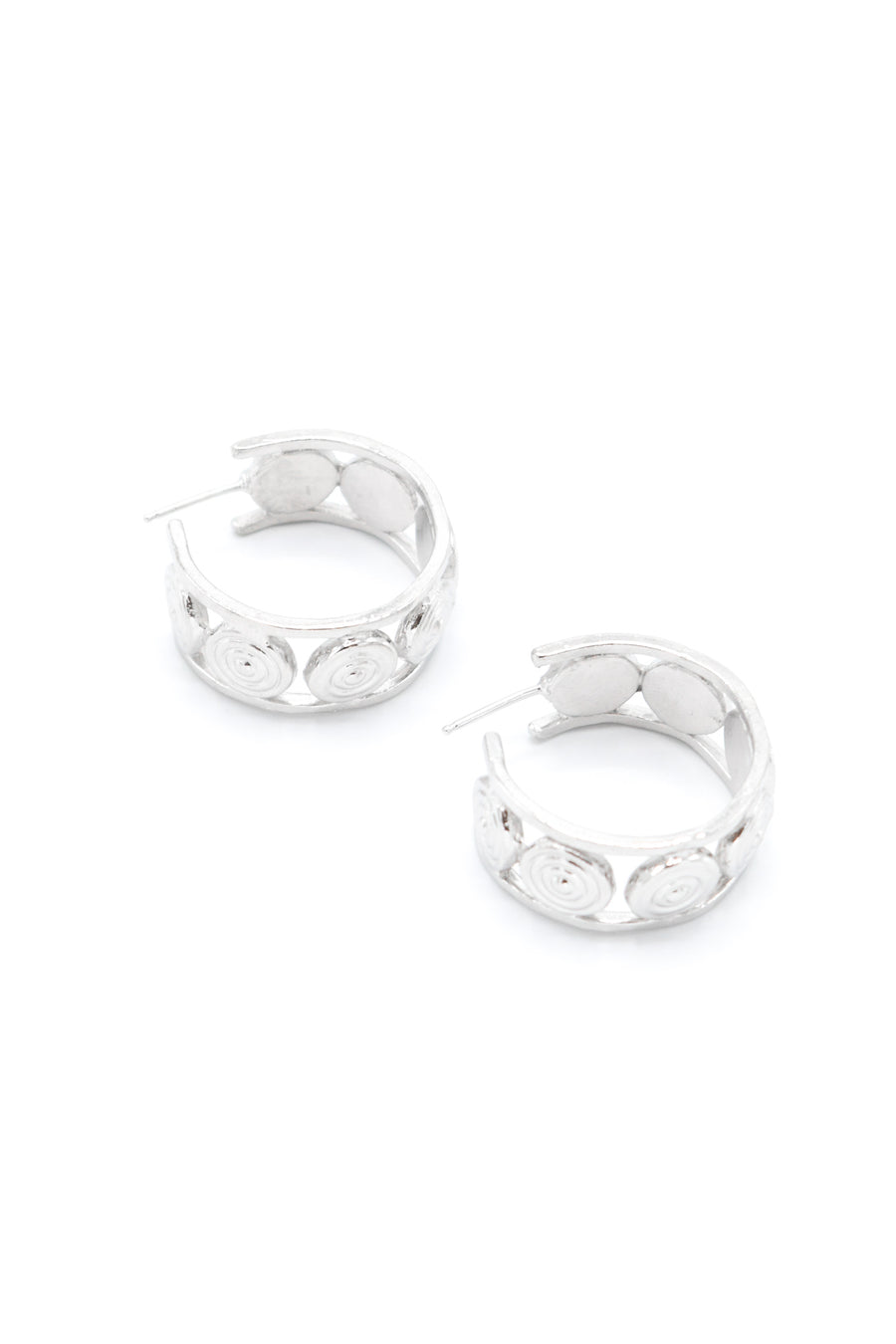 Aluna mini hoop earrings in white gold. Hoops with circular design and are 1 inch in diameter. Handmade by local jewelry designer, Nina Berenato, in Austin, Texas.