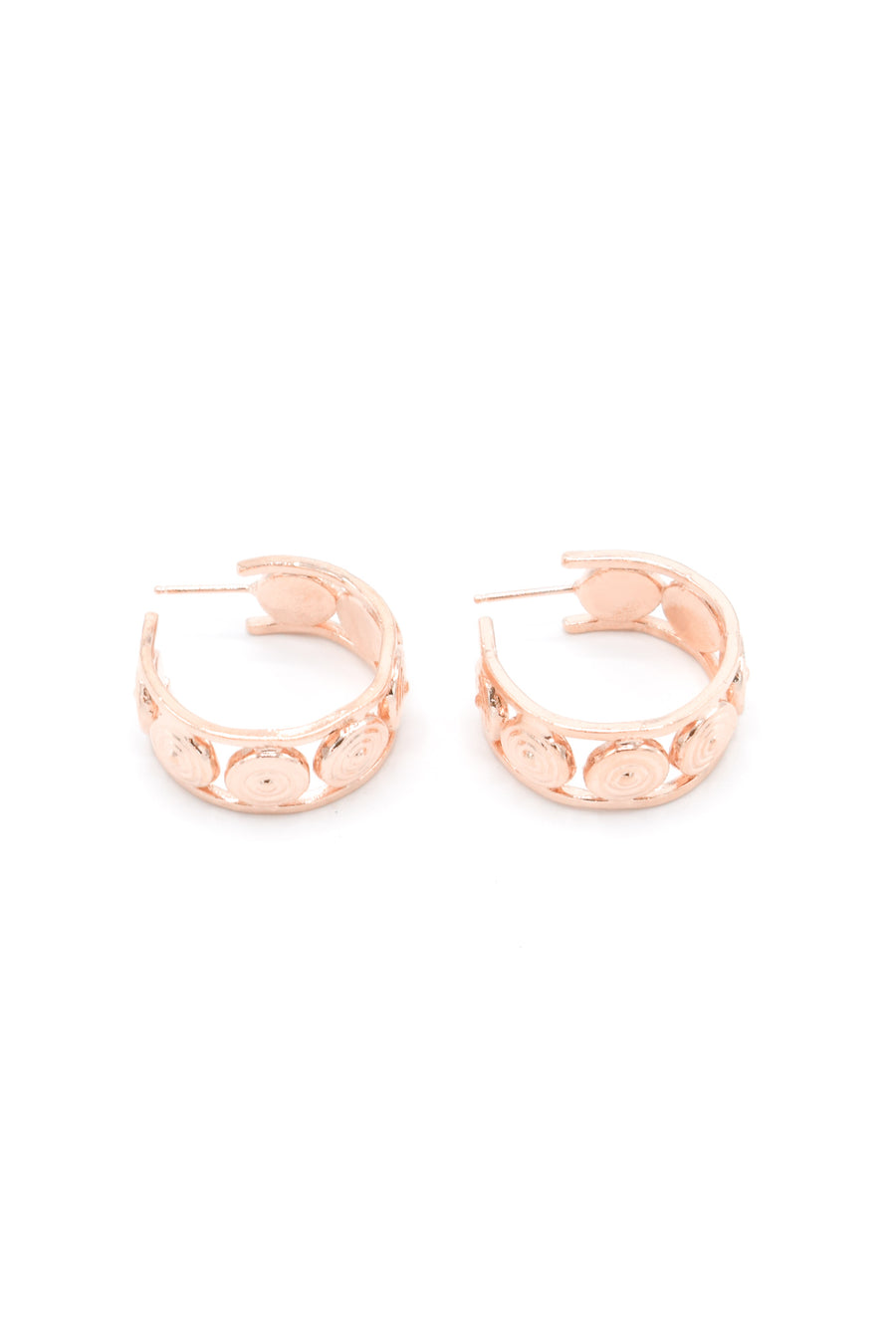 Aluna mini hoop earrings in 14k rose gold. Hoops with circular design and are 1 inch in diameter. Handmade by local jewelry designer, Nina Berenato, in Austin, Texas.