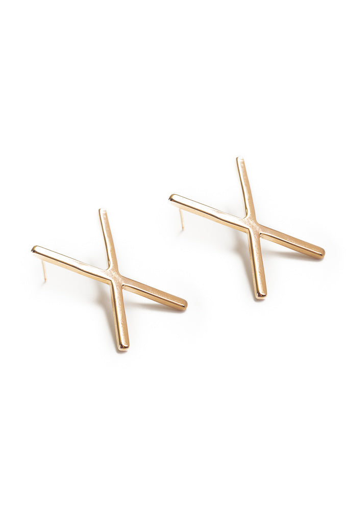 X earring in 14k yellow gold. Earring with X design. Handmade by local jewelry designer, Nina Berenato, in Austin, Texas.