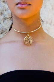 Globe necklace on model. 14k yellow gold choker necklace with globe like sculpture charm. Chin cuff on model. Handcrafted in Austin, Texas by designer, Nina Berenato, recently named BEST JEWELRY DESIGNER IN AUSTIN.