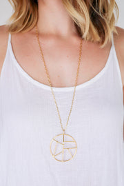 Mosaic necklace on model. 14k yellow gold geometric pendant necklace on a 30 inch chain. Hand made by local designer, Nina Berenato, in Austin, TX.