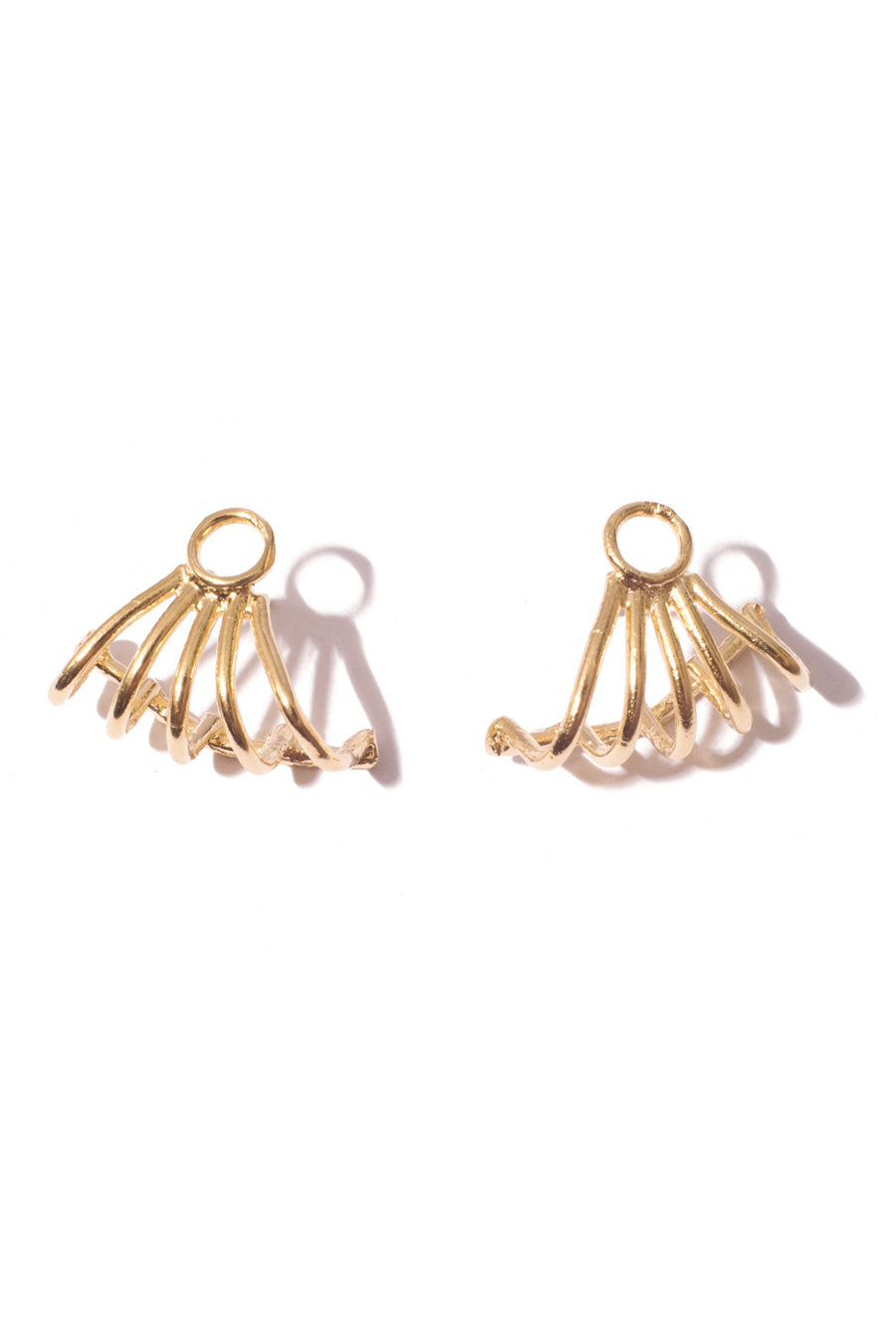 Inferno earring in 14k yellow gold. Earring that tucks underneath and hugs the lobe of the ear. Handmade by local jewelry designer, Nina Berenato, in Austin, Texas.