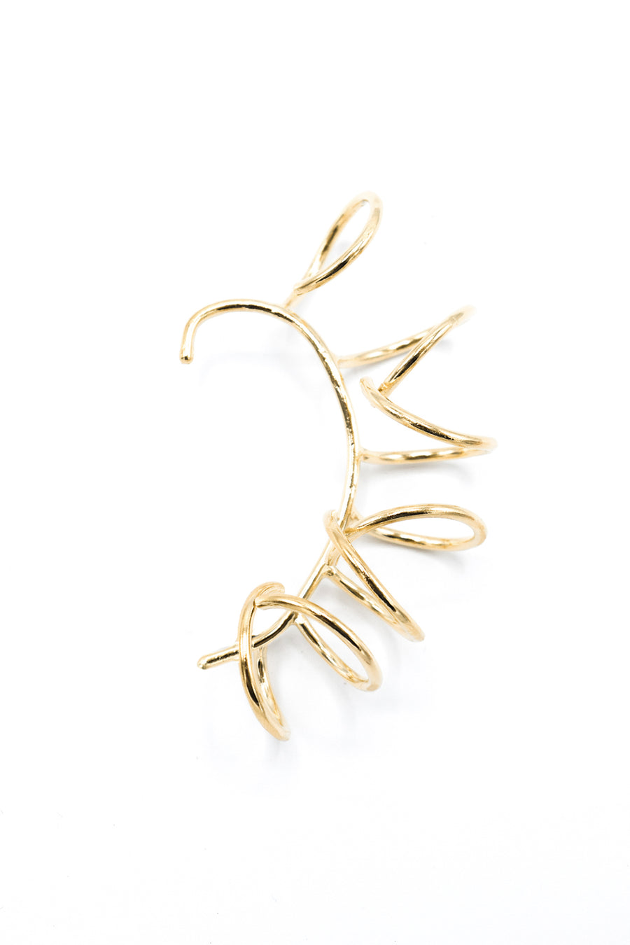 Rebel ear cuff in 14k yellow gold. One-sided ear cuff with multiple large coil design. No piercing required. Handmade by local jewelry designer, Nina Berenato, in Austin, Texas.