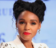 X earrings on Janelle Monae. 14k gold earring with x design. Handcrafted in Austin, Texas by designer, Nina Berenato, recently named BEST JEWELRY DESIGNER IN AUSTIN.