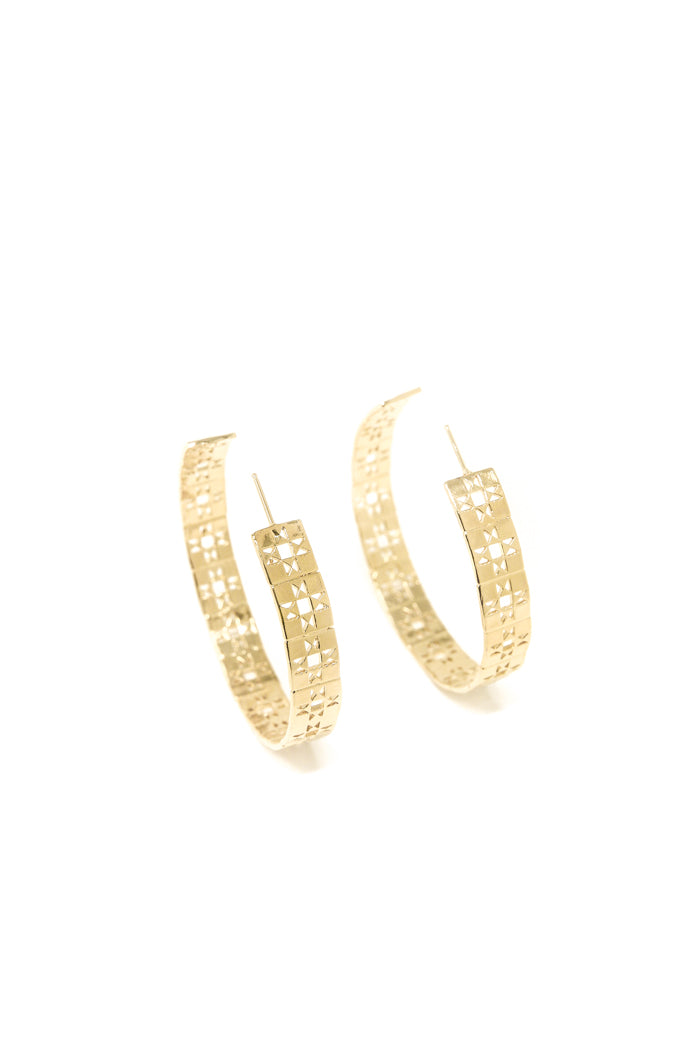 Large patchwork hoop earring in 14k yellow gold. Large hoop earrings with retro patchwork design. Handmade by local jewelry designer, Nina Berenato, in Austin, Texas.