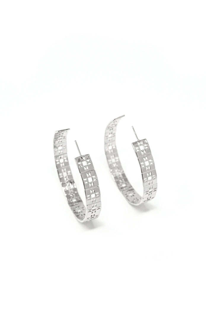 Large patchwork hoop earring in 14k white gold. Large hoop earrings with retro patchwork design. Handmade by local jewelry designer, Nina Berenato, in Austin, Texas.