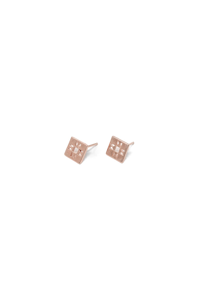 Oberlin square stud earring in 14k rose gold. Tiny quilt stud earrings with a retro patchwork design. Handmade by local jewelry designer, Nina Berenato, in Austin, Texas.