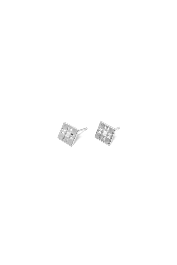 Oberlin square stud earring in 14k white gold. Tiny quilt stud earrings with a retro patchwork design. Handmade by local jewelry designer, Nina Berenato, in Austin, Texas.