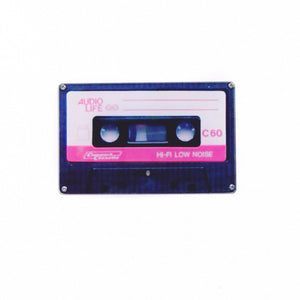 Black cassette tape flair pin with pink and white label