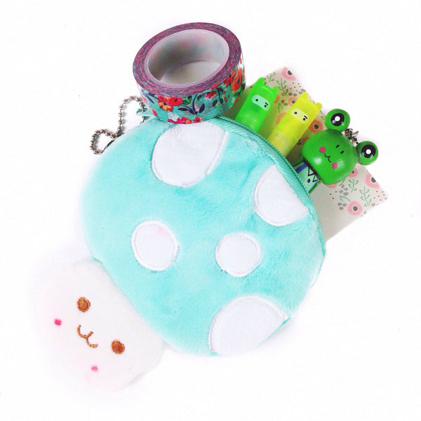 Mint colored, mushroom shaped coin pouch with washi tape, wooden frog pen and ninja highlighters inside