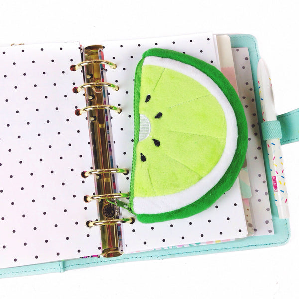 Lime shaped coin purse on the pages of a mint Kikki K planner